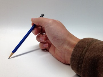 hand holding blue pencil from rear