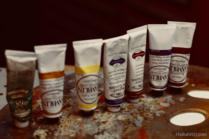 oil paint tubes lined up on palette